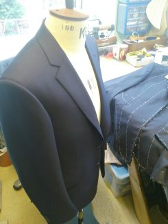 The completed suit is finished off with edge stitching and hand bound buttonholes. the basting threads holding in the floating canvas are ripped out and the garments are ready for a final press with a 12lb iron.